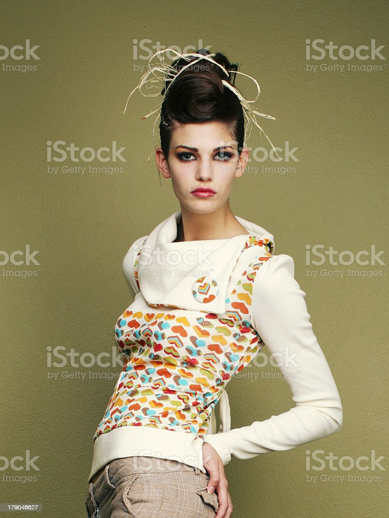 Young Woman in Hearts Sweater on Green Wall royalty-free stock photo