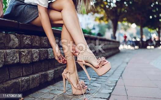 Young beautiful woman is wearing high heel sandals