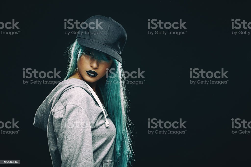Young woman in hoodie and cap stock photo