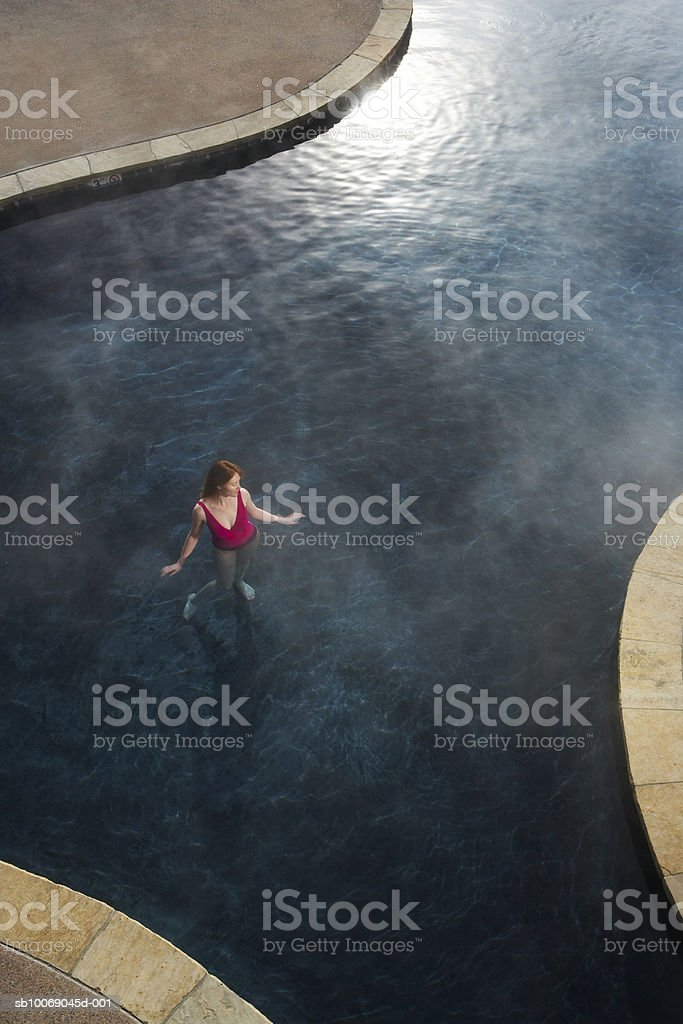 Young woman in hot tub, elevated view royalty-free stock photo