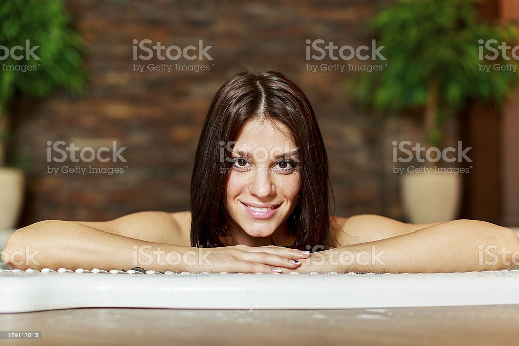 Young woman in hot tub royalty-free stock photo