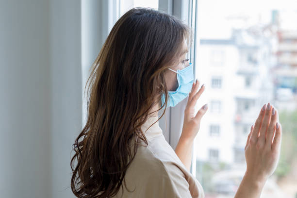 Young woman in isolation at home for coronavirus stock photo