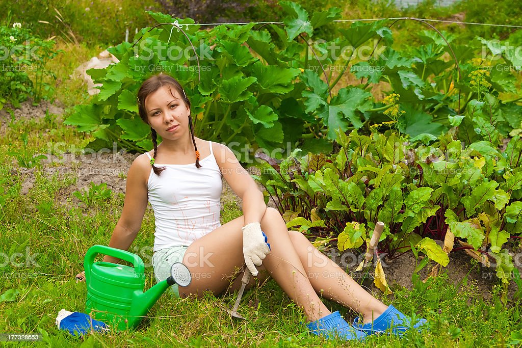 Young woman in kitchen-garden stock photo