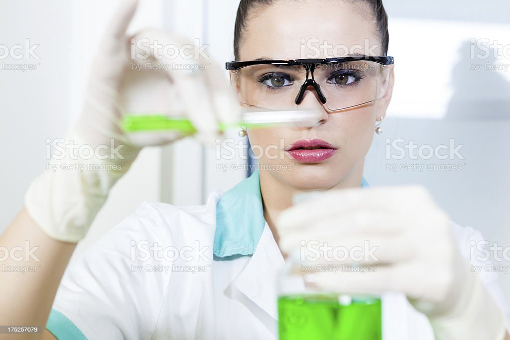 Young woman in laboratory royalty-free stock photo