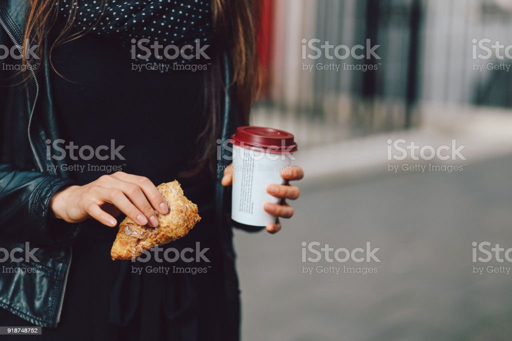 Young woman in London having a coffee on the go stock photo