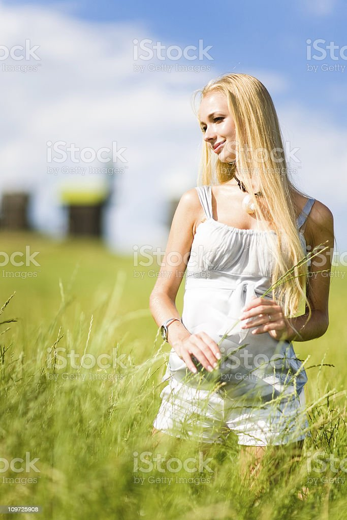 Young Woman in Meadow royalty-free stock photo