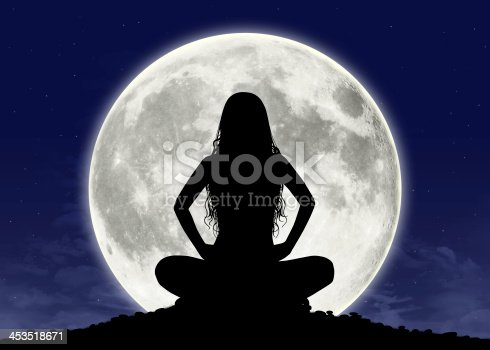 1008093204 istock photo young woman in meditation at the full moon 453518671