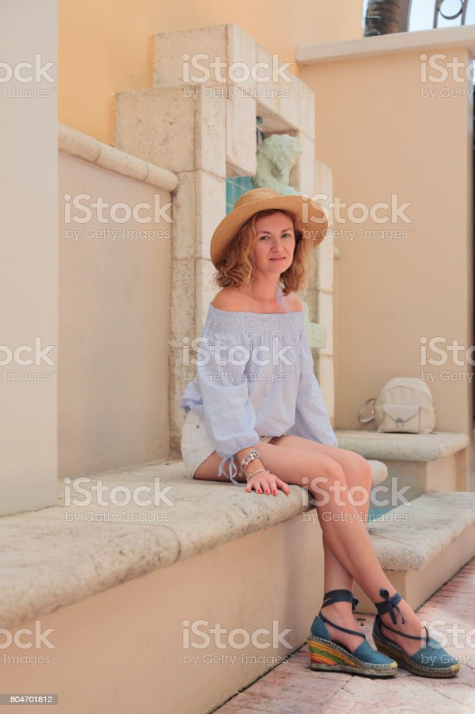 Young woman in Mediterranean style downtown. stock photo