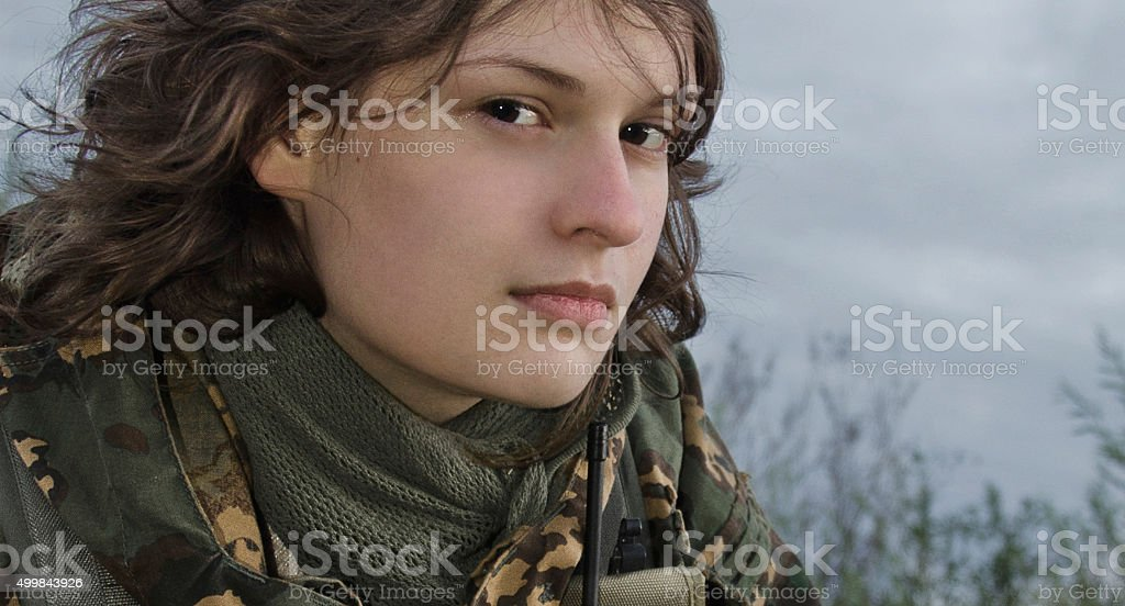 young woman in military uniform stock photo