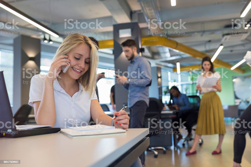 Young woman in modern office royalty-free stock photo