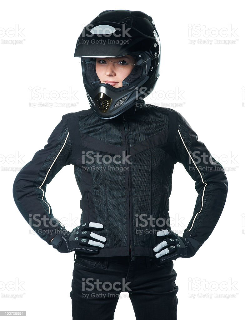 Young woman in motorcycle attire stock photo