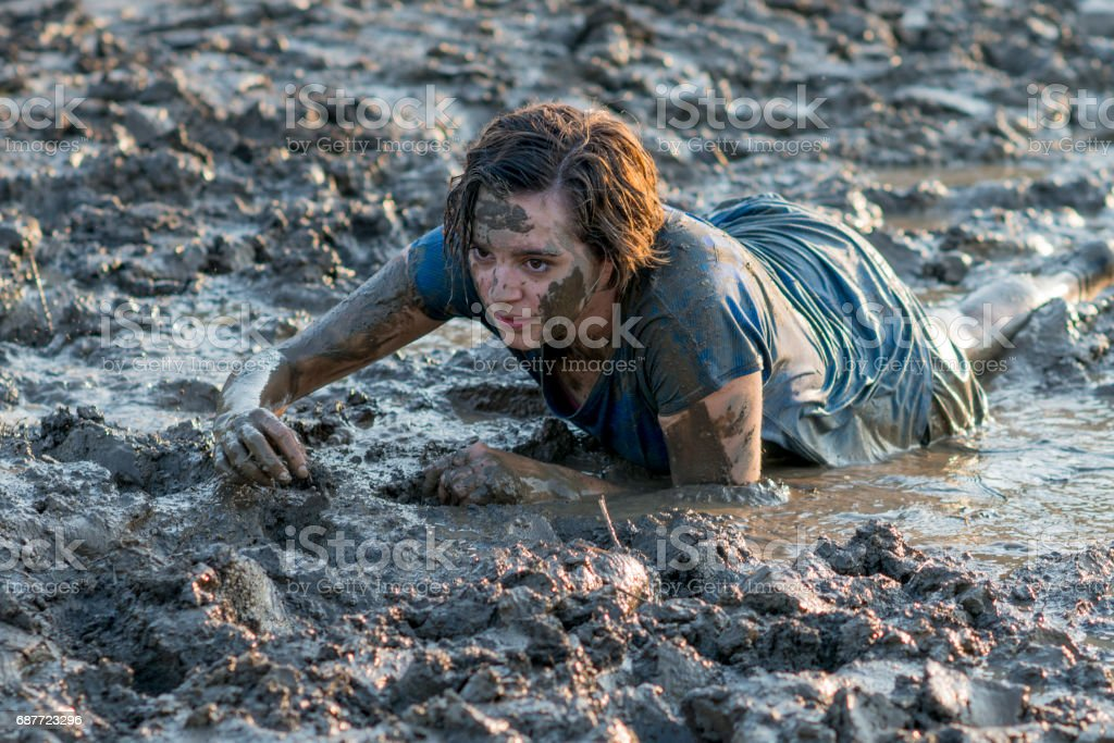 Young Woman in Mud Run stock photo