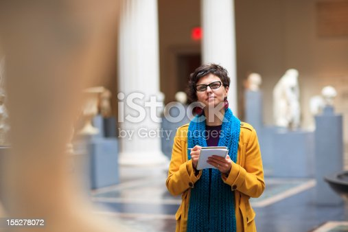 Woman in museum takes notes as she is looking at fine art statue.  ***PLEASE TAKE YOUR TIME TO TELL ME WHERE MY IMAGE WAS USED***