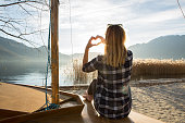 istock Young woman in nature making heart shape finger frame 639403248
