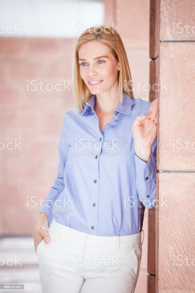 Young woman in office hall royalty-free stock photo