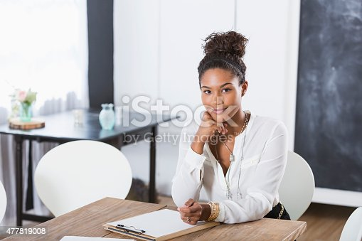istock Young woman in office meeting room 477819008