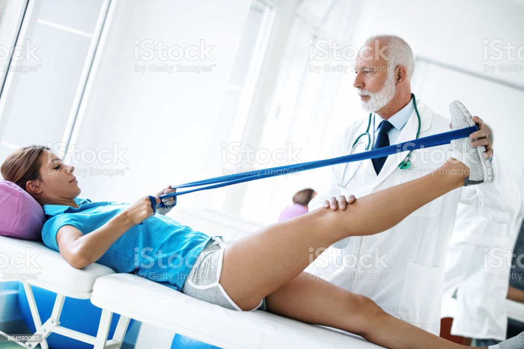 Young woman in physical therapy. stock photo