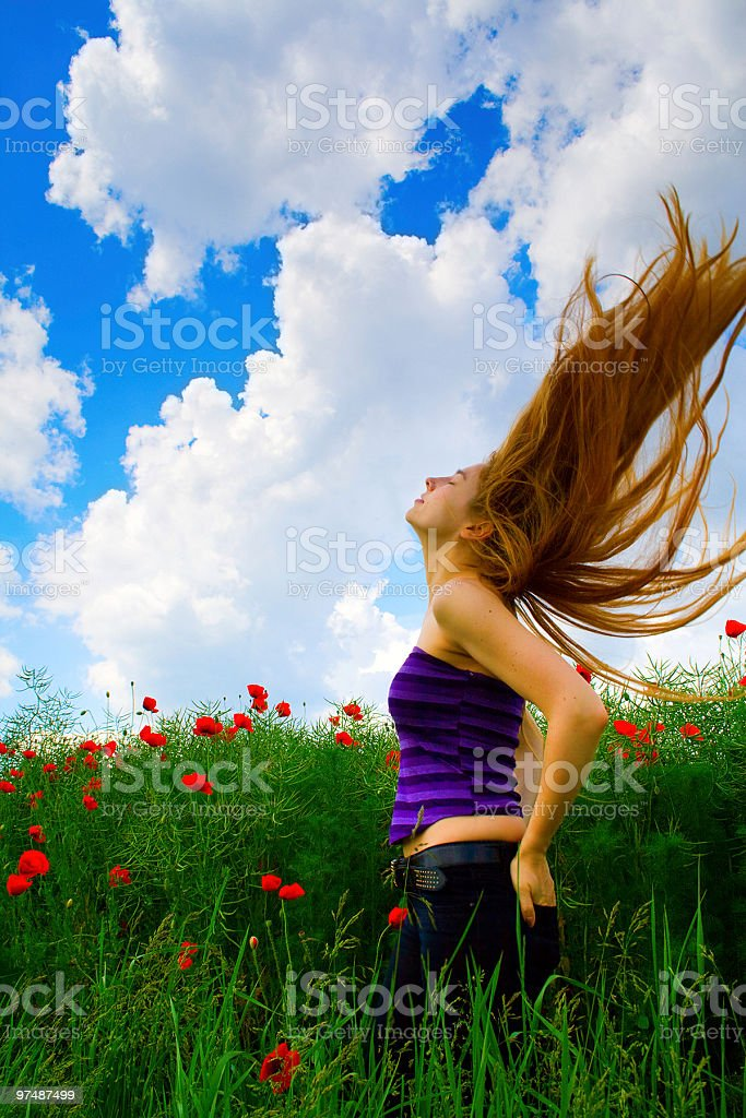 Young woman in poppy field royalty-free stock photo