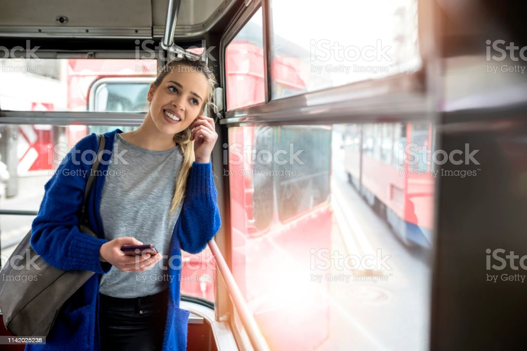 Young woman riding in public transportation