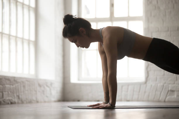 young woman in push ups or press ups pose, closeup - peso mosca foto e immagini stock