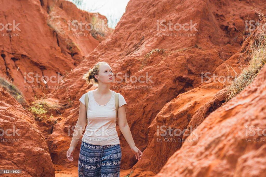 Young woman in red canyon near Mui Ne, southern Vietnam stock photo