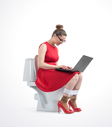 Young Woman Checking Social Media On The Toilet High-Res