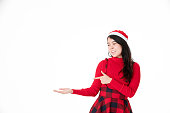 Young woman in red dress and santa hat.