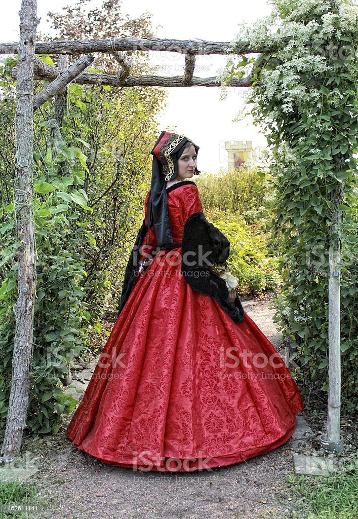 Young Woman in Red Renaissance Dress stock photo