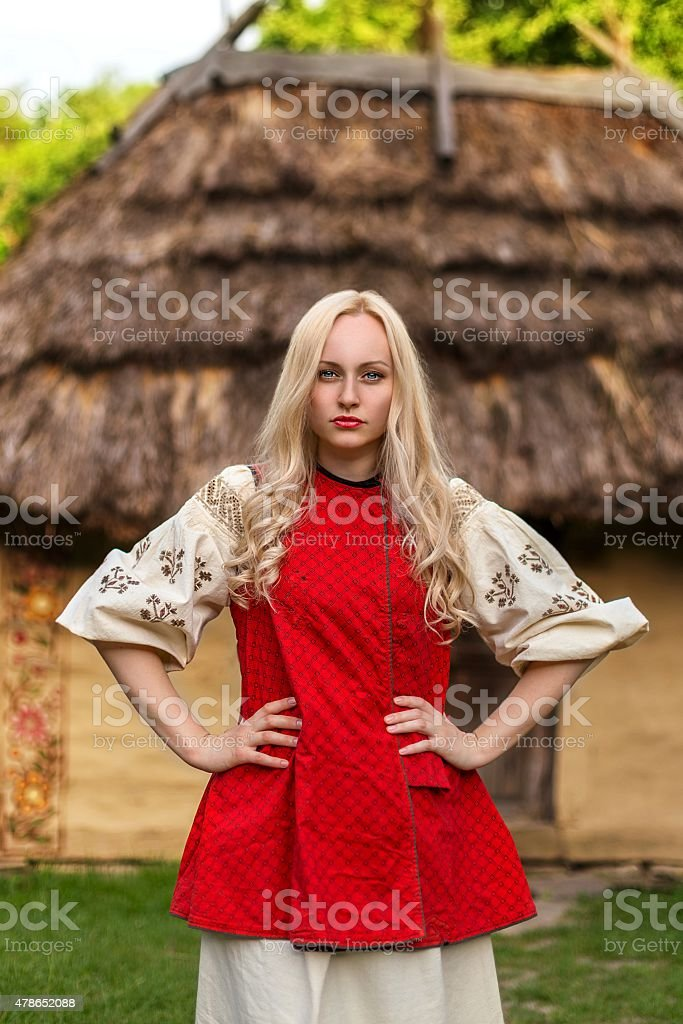 Young woman in red ukrainian national costume stock photo