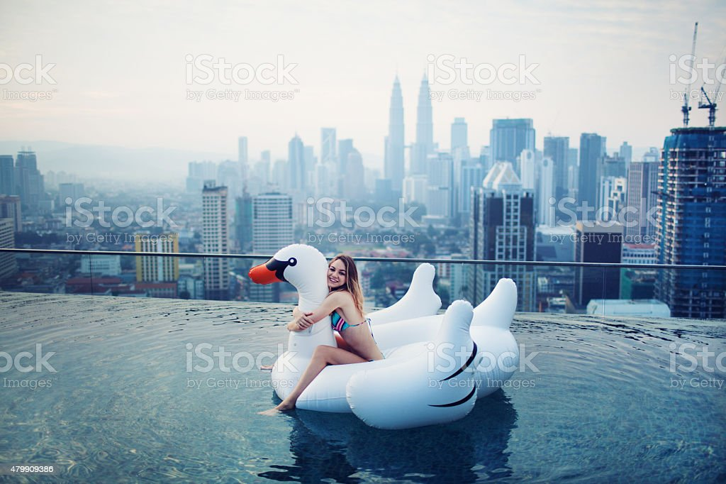 Young Woman in Rooftop Pool stock photo