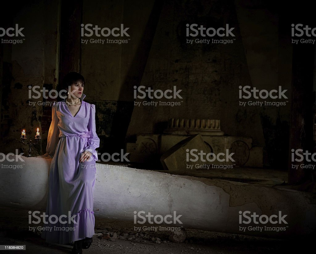 Young woman in ruined building royalty-free stock photo