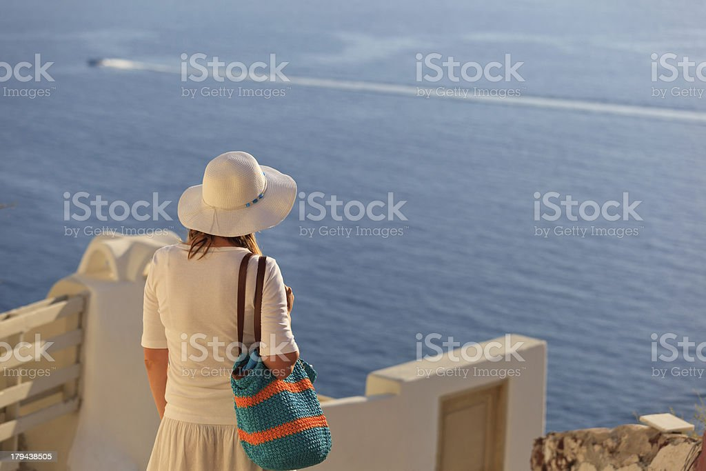 young woman in Santorini, Greece royalty-free stock photo