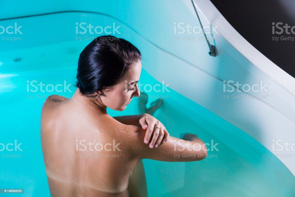 Young Woman In Sensory Deprivation Tank Stock Photo - Download Image Now