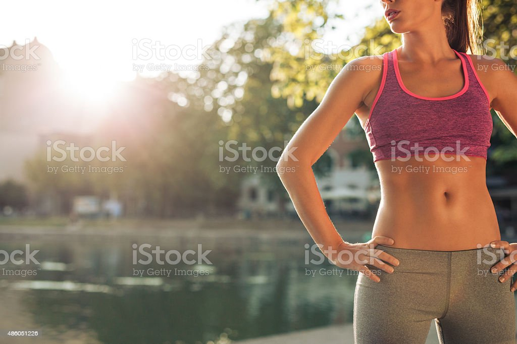Young woman in sportswear with fit body stock photo