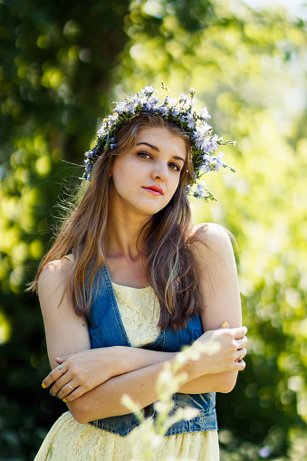 young woman in summer forest