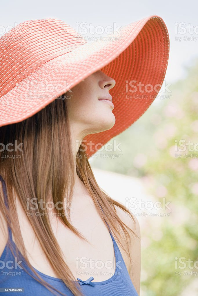 Young Woman in Sun Hat stock photo