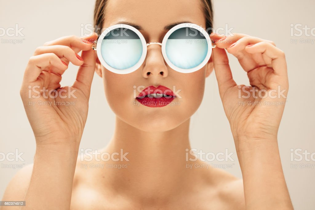 Young woman in sunglasses and red lips royalty-free stock photo