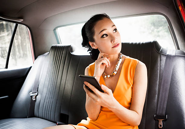 young woman in taxi - asian travel in car stock photos and pictures