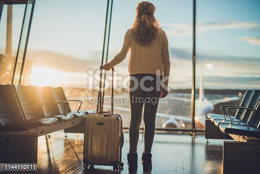istock Young woman in the airport. 1144110111