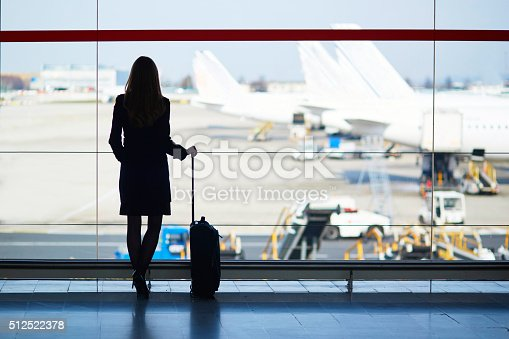 istock Young woman in the airport 512522378