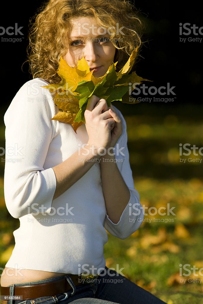 Young woman in the autumn park royalty-free stock photo