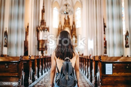 Young woman inside a famous cathedral in Novi Sad, Serbia