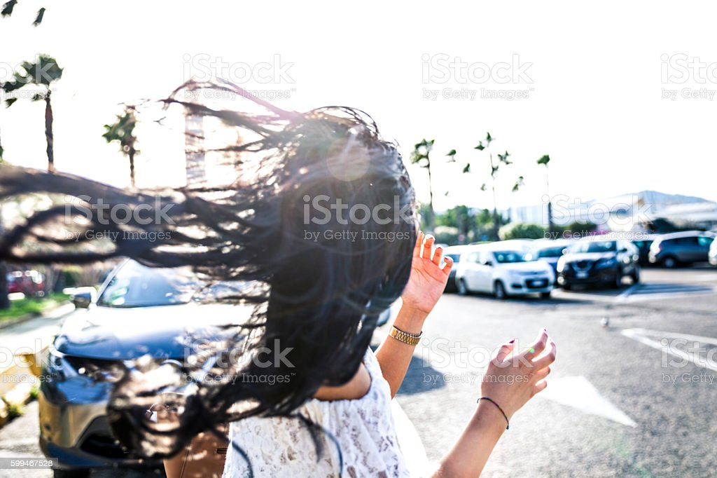 Young woman in the city street during a beautiful day stock photo