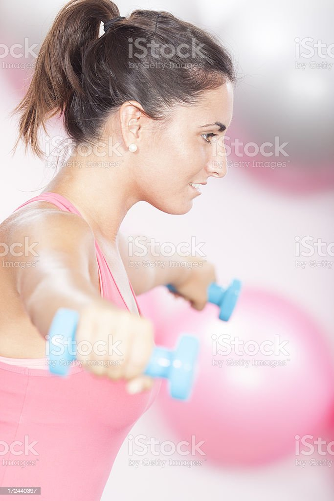 young woman in the fitness studio royalty-free stock photo