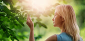 istock young woman in the forest on sunny summer day 1271397116