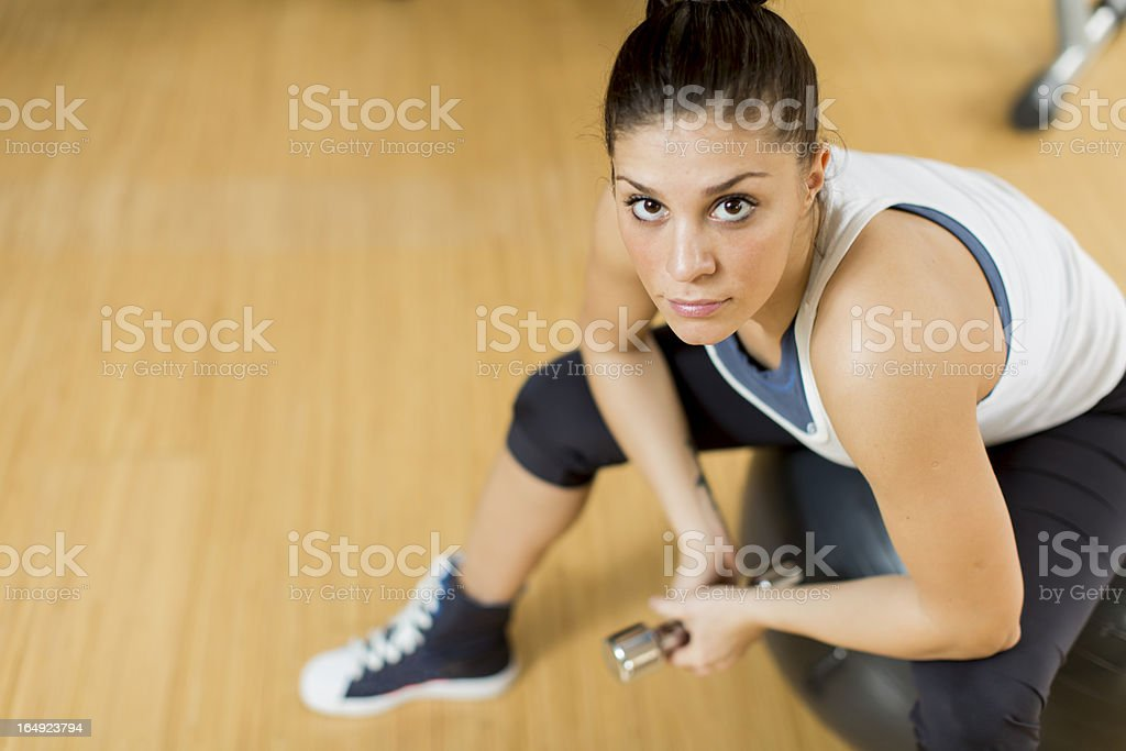 Young woman in the gym royalty-free stock photo