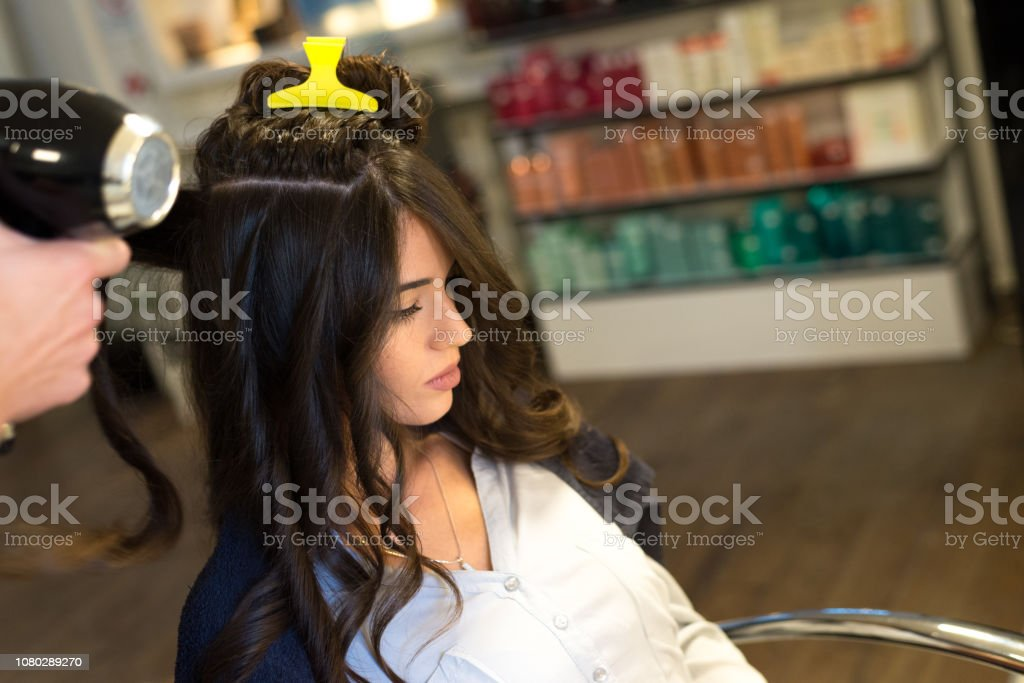 Young woman in the hair salon stock photo