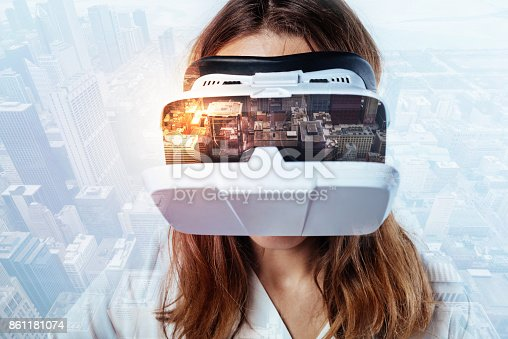 1162297213 istock photo Young woman in the incredible virtual reality glasses 861181074