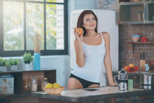 Young woman in the kitchen lifestyle stock photo