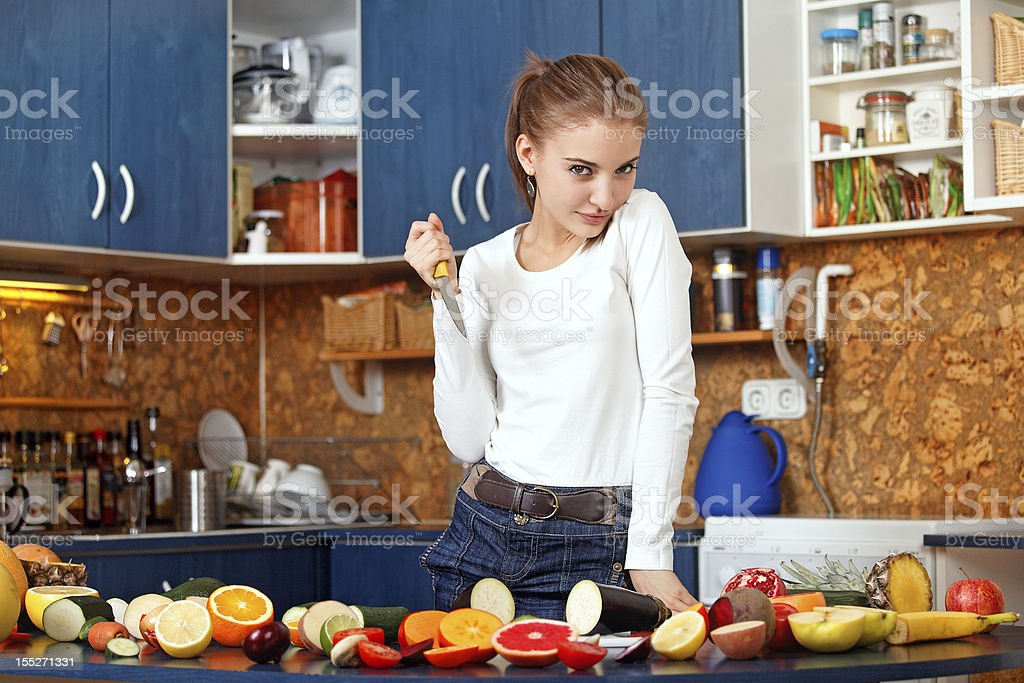 young woman in the kitchen royalty-free stock photo